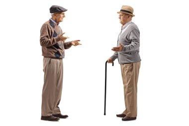 Full length shot of two elderly men having a conversation isolated on white background