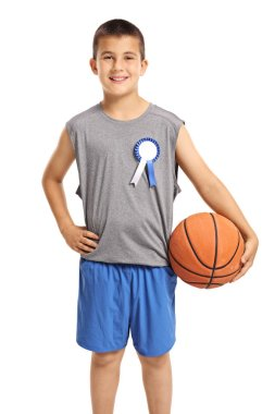 Young boy with a winner badge and basketball isolated on white background