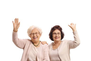 Two cheerful elderly women waving isolated on white background