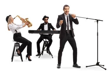 Woman playing sax, man playing a keyboard and a male singer sing