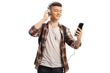 Young guy listening to music from mobile phone