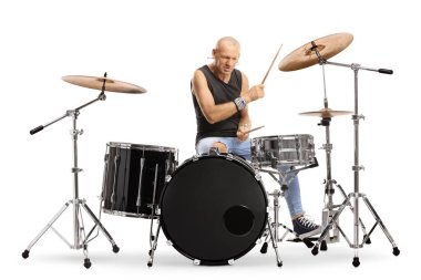 Bald man drummer playing a drum set isolated on white background
