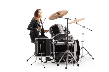 Young female musician playing a drum kit isolated on white background
