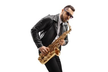 Male musician in a leather jacket wearing sunglasses and playing a saxophone isolated on white background