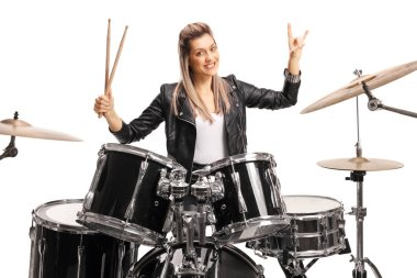Beautiful female musician playing percussion drums isolated on white