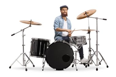 Bearded musician playing a set of drums isolated on white background