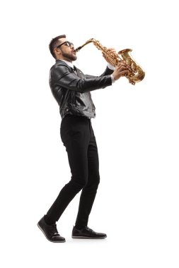 Full length profile shot of a musician playing a saxophone and wearing sunglasses  isolated on white background