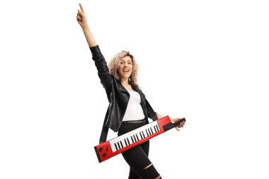 Full length portrait of a young female musician with a keytar synthesizer gesturing with hand isolated on white background