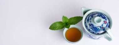 Chinese tea cup accompanied by peppermint