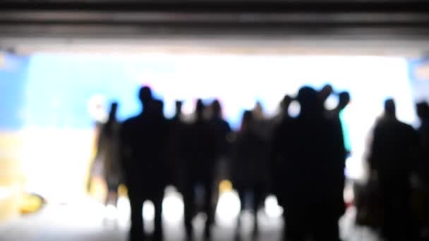 Blurred background. People come to light from an underground passage