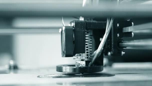 Modern 3D printer printing an object from the hot molten.
