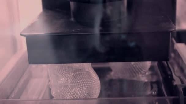 Stereolithography DPL, SLA 3d printer creating shape by UV polymerization