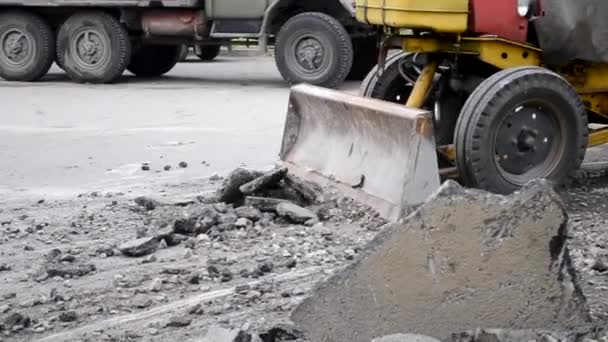 Tractor moves asphalt