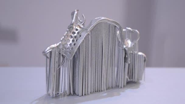 Modern 3D printer printing from metal powder.