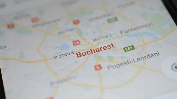 Gomel, Belarus - May, 2018: Person using a Google Maps application on Android device. Bucharest map