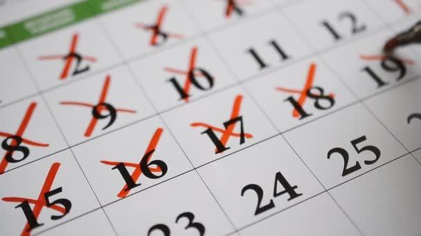 Podepsání pomocí červené pero den v kalendáři