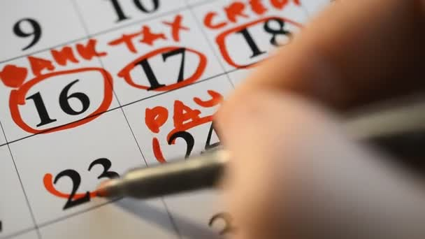 Signing a day a calendar by color marker