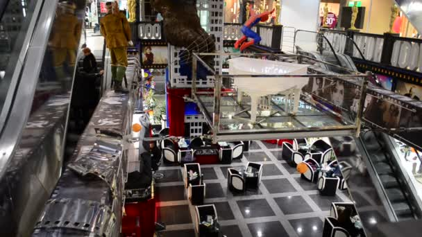 Ladders and shops. Filming in the mall.