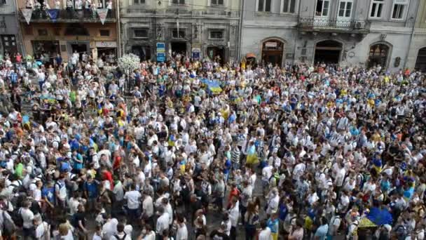 Fans of soccer sing anti-Russian and against V.Putin songs in connection with military aggression of Russia against Ukraine in the Ukraine on July 22, 2014 in Lviv.