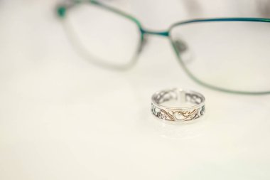glasses and jewelry, on table