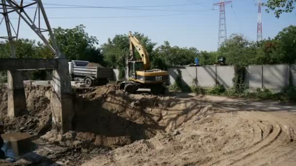 Timelipse. Excavator digs a pit. construction of an industrial building foundation
