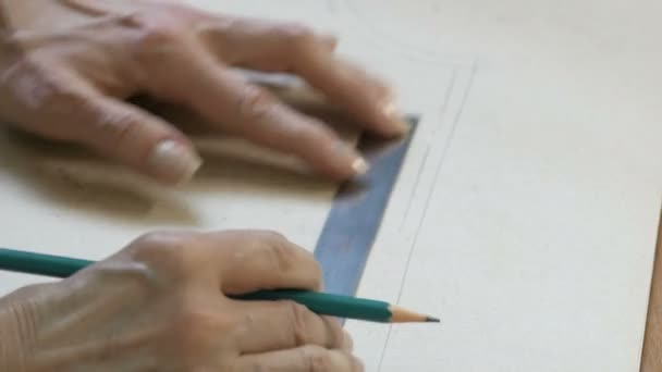 Seamstress ruler and pencil in hand is making drawings for clothes  Style  and design development and creating garment, clothes sew and repair  service, tailor concept