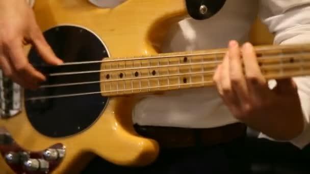 musician plays bass guitar. hands on the fingerboard