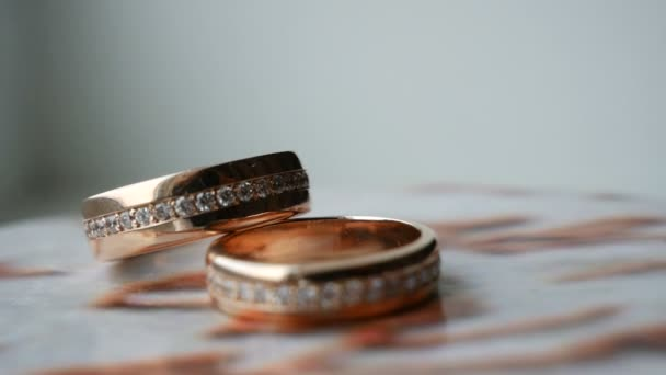 Wedding rings with gems spinning on stand
