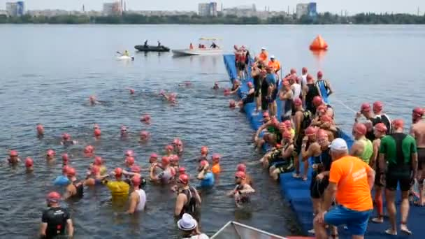 DNIPRO, UKRAINE-June 9, 2019: Dnipro Triathlon Festival, athletes are preparing for competition of swimming, June 9, 2019 in Dnipro, Ukraine