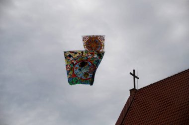 Various kites flying in the blue sky at the kite festival, Zapyskis, Lithuani