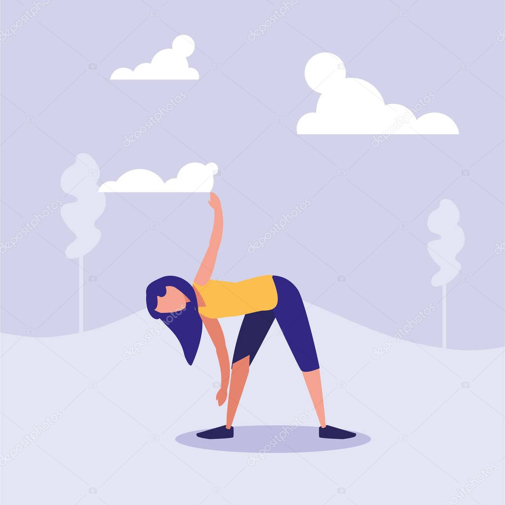 woman practicing stretching in landscape