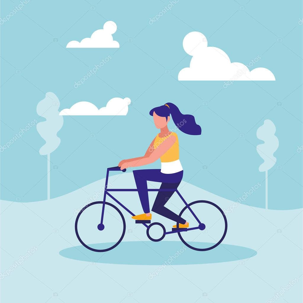 woman practicing cycling in landscape