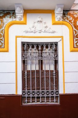 picturesque window at a typical Andalusian house in Seville, Spain
