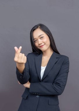 asian lady with business uniform suite with mini heart