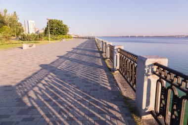 Promenade with paving stone and wrought iron railing in  Dniprop