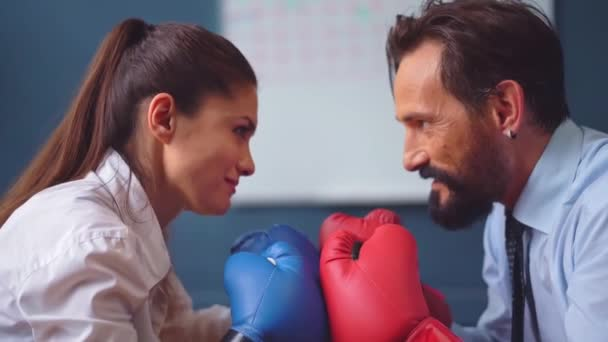 Woman struggling with man in business clothes trying hard to stand stronger and to resist. Business people vie boxing on gloves. Gender Conflict Concept. Prores 422