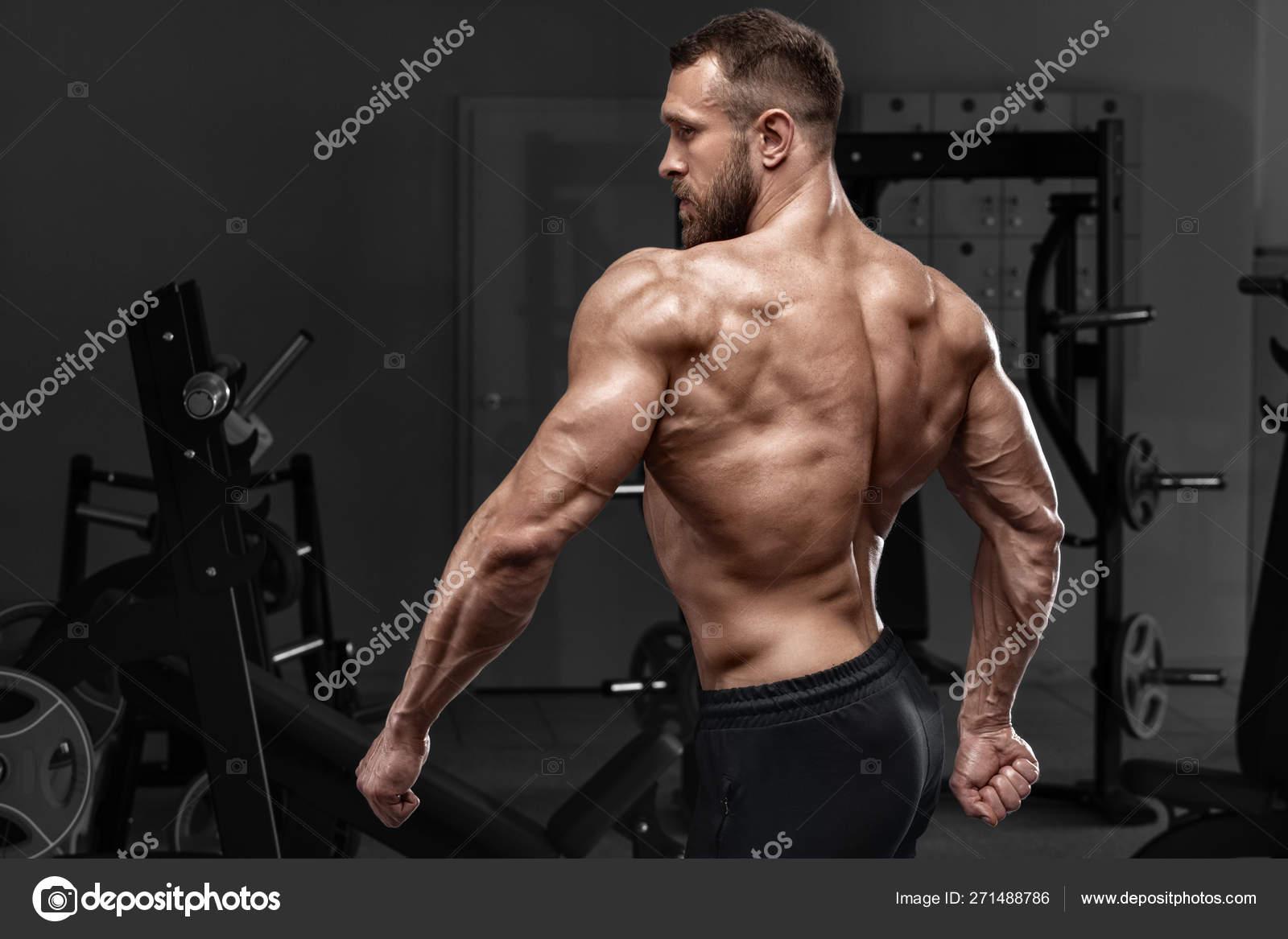 Rear View Muscular Man Showing Back Muscles Gym Strong Male Stock Photo C Nikolas Jkd 271488786 Joué 68,299 fois nécessite un module d'extension. rear view muscular man showing back muscles gym strong male stock photo c nikolas jkd 271488786