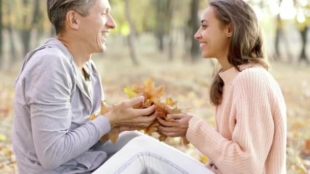 Young Lovely Couple In Autumn Park Outdoors