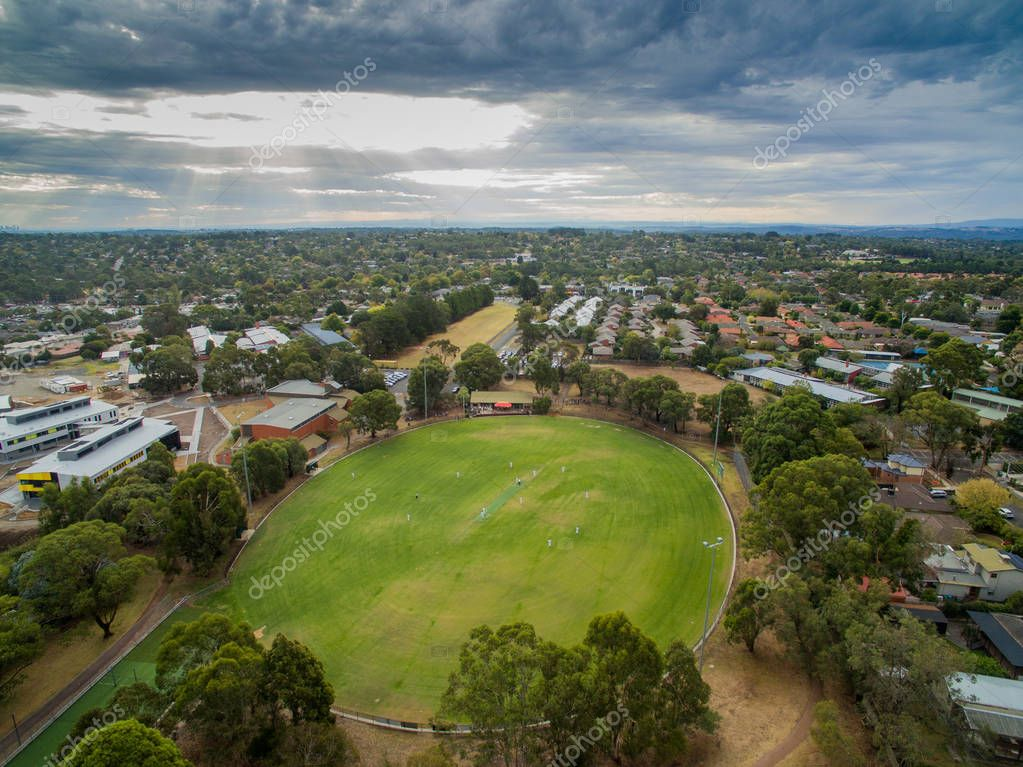 AUSTRALIA, MELBOURNE - MAY 24, 2018: Amaturer cricket game being played on a Suburban cricket ground in the outer suburbs of Melbourne