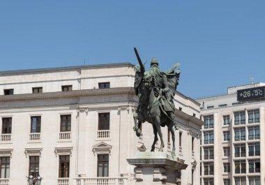 BURGOS, SPAIN - JULY 22 - 2020: View of the statue of Rodrigo Diaz de Vivar called the CID and emblem of the city of Burgos on a summer day