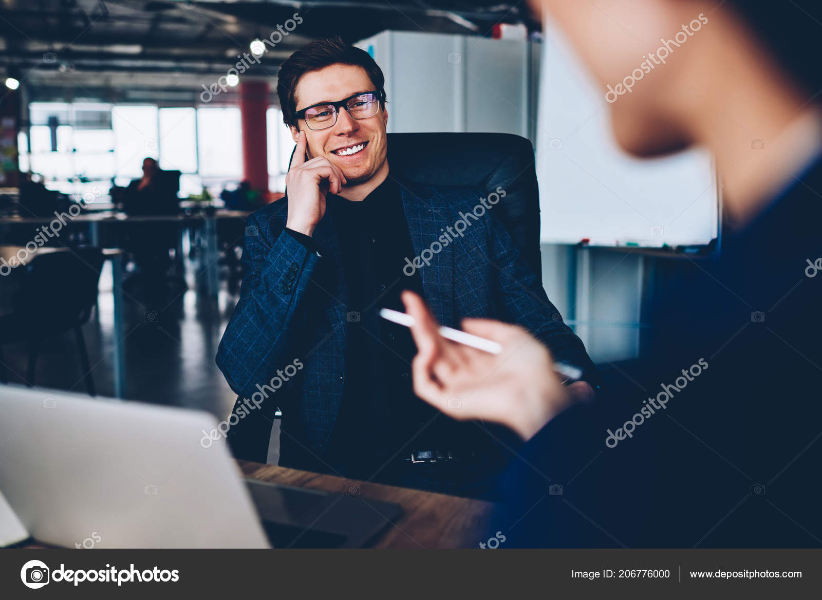 f23039e2c221 Cheerful male boss in formal wear having friendly talk with employee  satisfied with her job