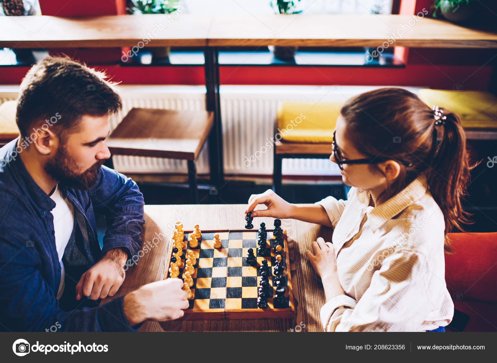 Top View Two Intelligent Hipster Students Playing Chess