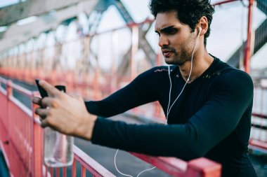 yuong sporty man listening to music