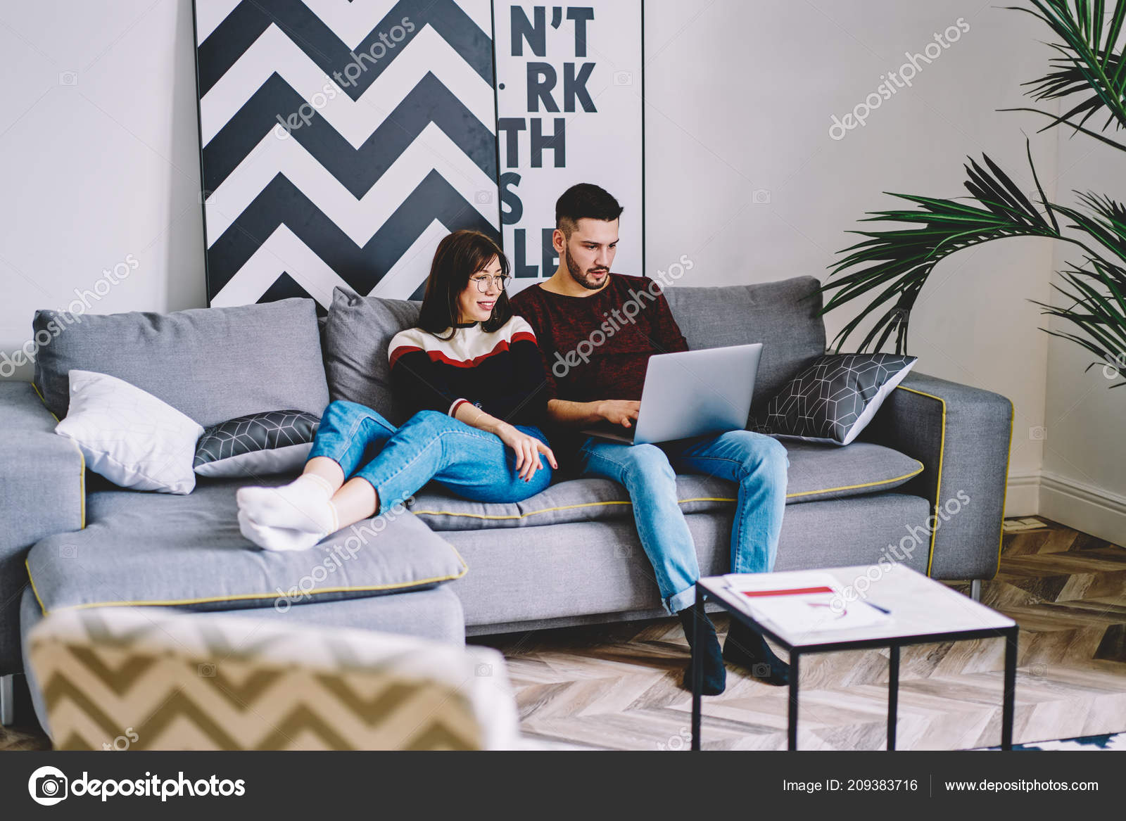 Young Man Booking Tickets Website Modern Laptop Sitting Comfortable Couch Stock Photo C Gaudilab 209383716
