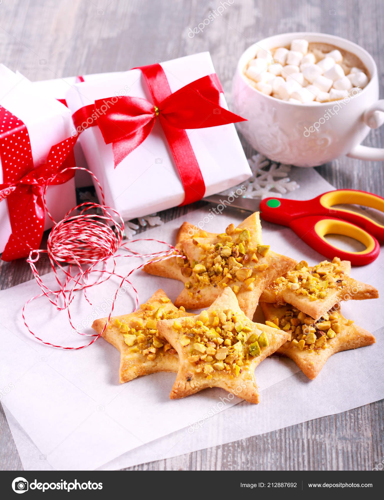 Crunchy Pistachio Christmas Star Biscuits Table Stock Photo