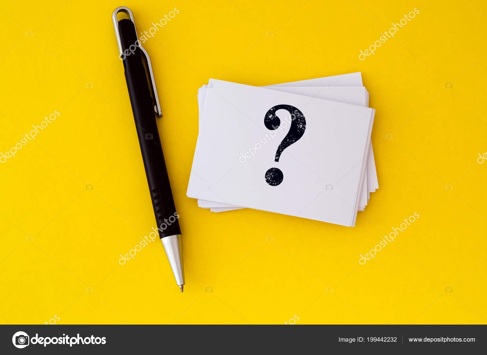 Stacking white business card written question mark symbol vibrant stacking of a white business card with written question mark symbol on vibrant yellow background questions and answers or qa concept design foto de reheart Images