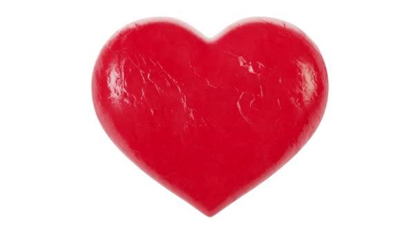 Červené srdce se změní na černou. 3D vykreslování.