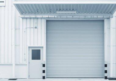 Shutter door outside factory, blue color tone.