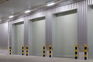 Shutter door or roller door and concrete floor outside factory building use for industrial background. stock vector