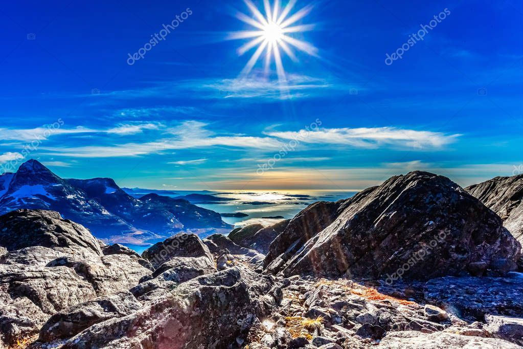 Polar arctic greenlandic  sun in its zenith over the fjord and mountains landscape, Nuuk, Greenland